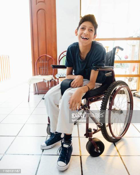 teenager boy with cerebral palsy - assistive technology stock photos and pictures