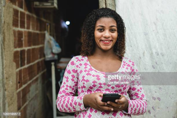 teenager brazilian using a smartphone - humility stock pictures, royalty-free photos & images