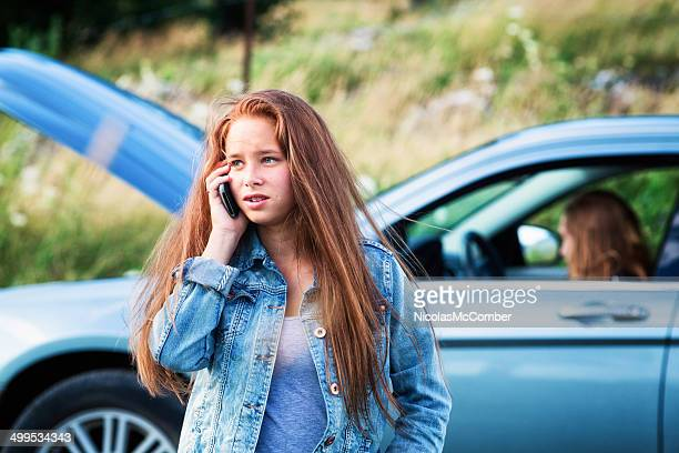 Teenager calling dad for help with car breakdown
