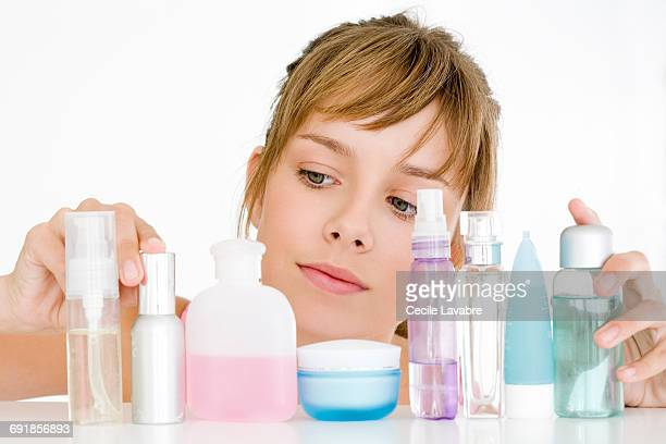 Teenager choosing skincare products