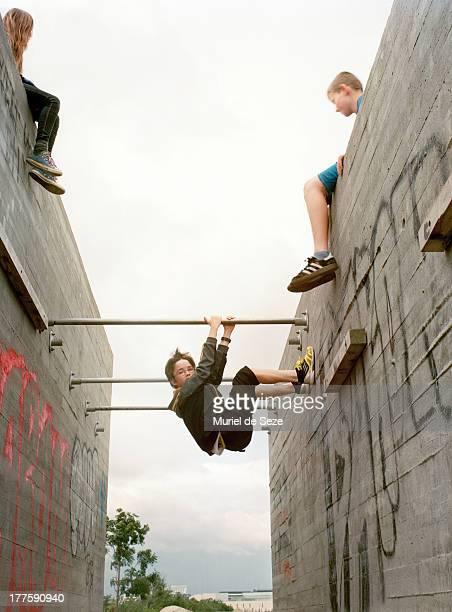Teenager climbing walls