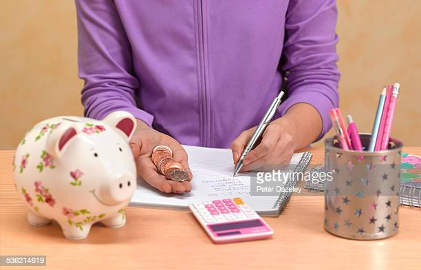 Teenager counting pocket money