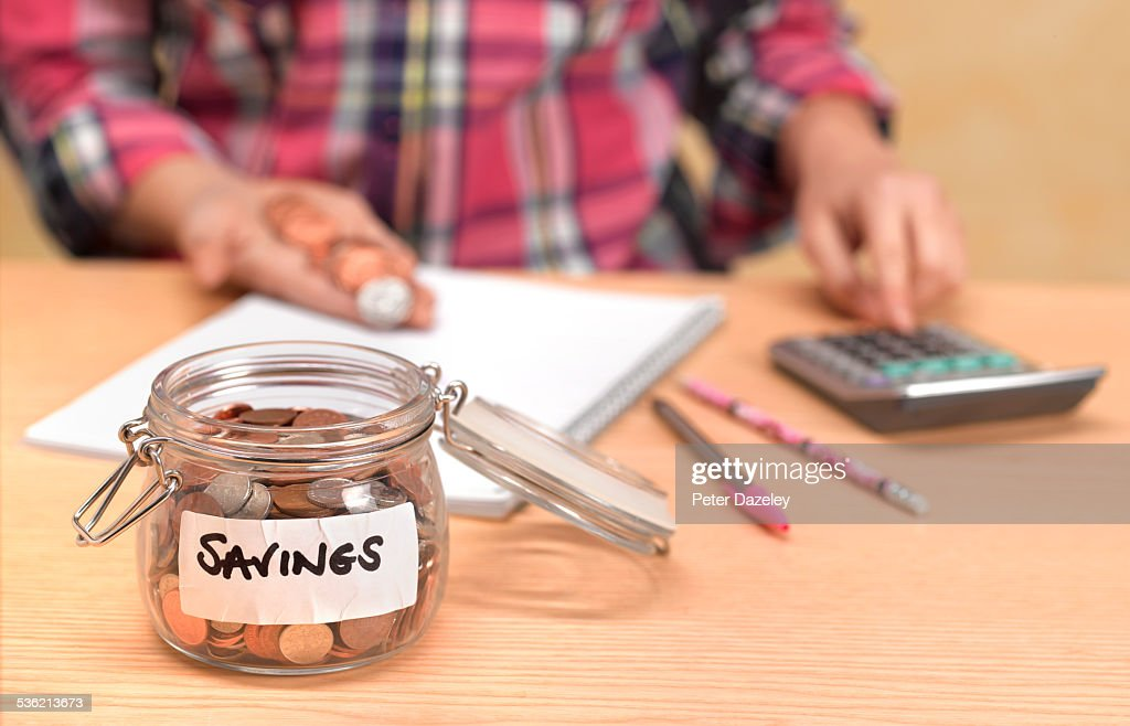 Teenager counting savings : Stock Photo
