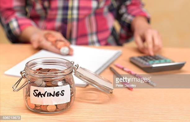 Teenager counting savings