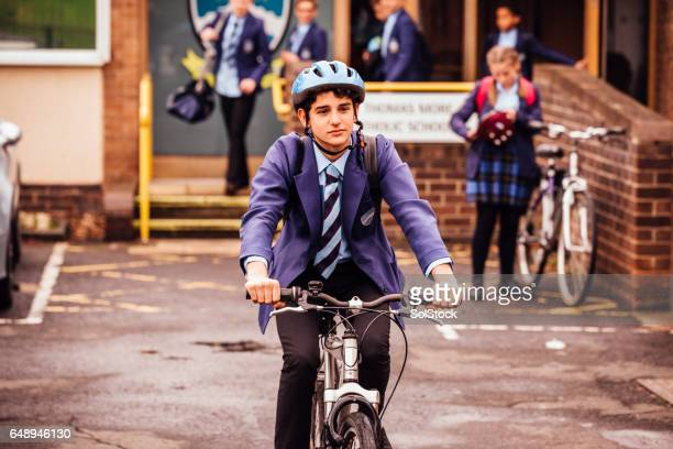 Teenager Cycles to School and Back