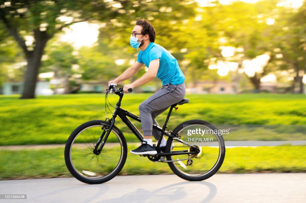 Teenager cycling on the neighborhood : Stock Photo
