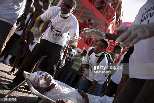 A teenager depicting a cholera victim is carried on a cot by others acting as clinic workers in a parade during carnival weekend in Jacmel Haiti...