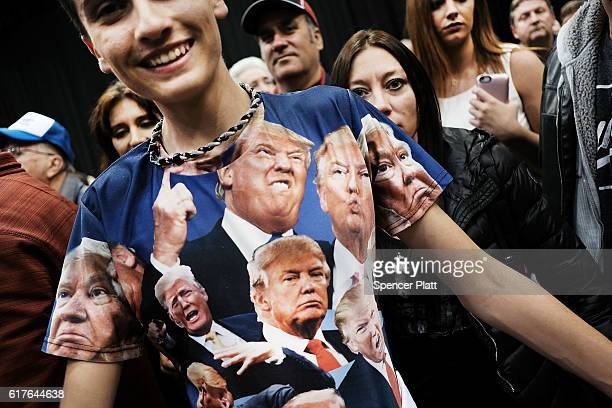 A teenager displays a Donald Trump shirt at a Trump rally on October 22 2016 in Cleveland Ohio The election is November 8