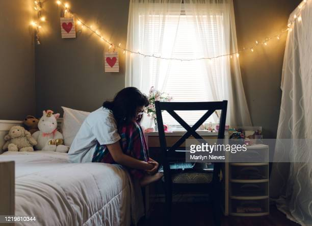 """teenager doing homework in her room - """"marilyn nieves"""" stock pictures, royalty-free photos & images"""