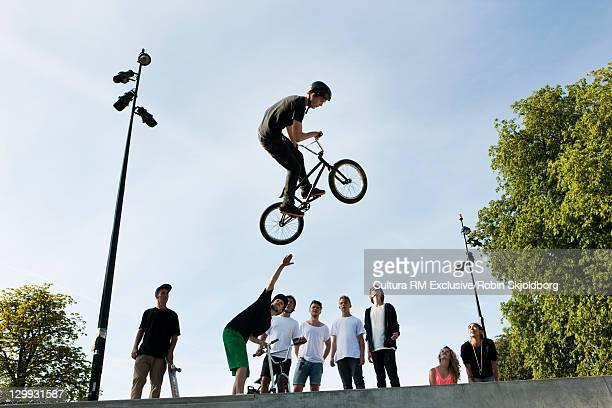 Teenager doing tricks on bmx bike