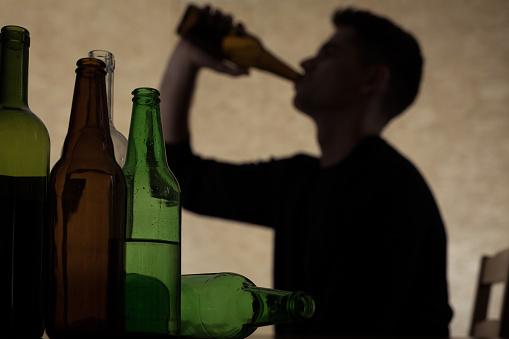 Teenager drinking beer 492456096