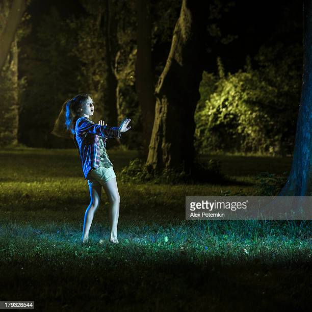 teenager girl are scared of something in night park