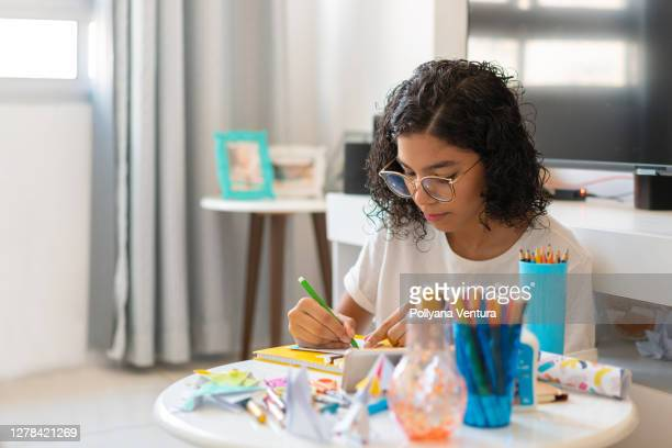 teenager girl drawing in the living room - pencil case stock pictures, royalty-free photos & images