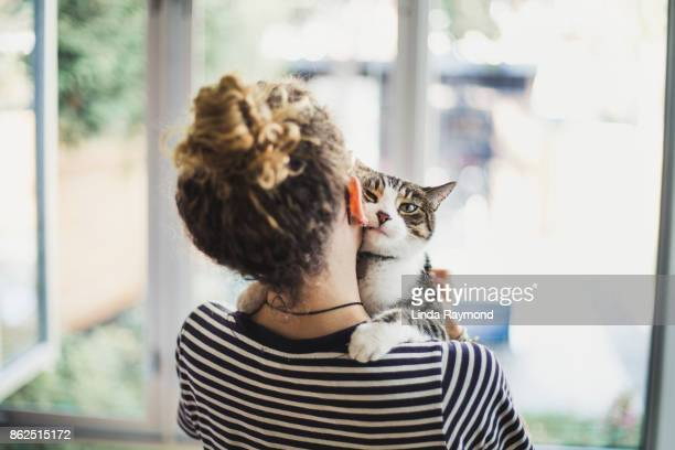 a teenager girl holding her cat - image stock pictures, royalty-free photos & images