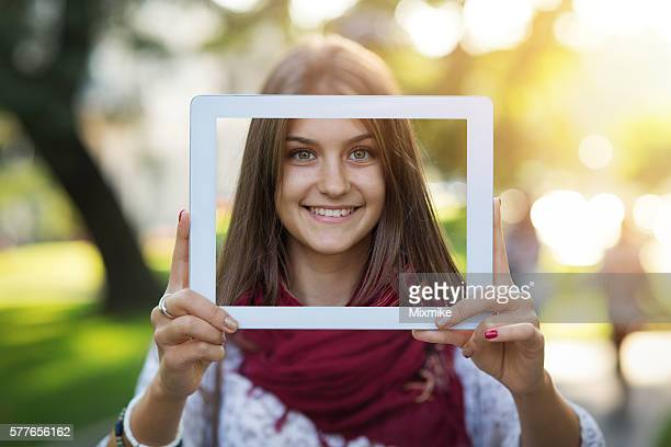 Teenager girl holding tablet with a selfie