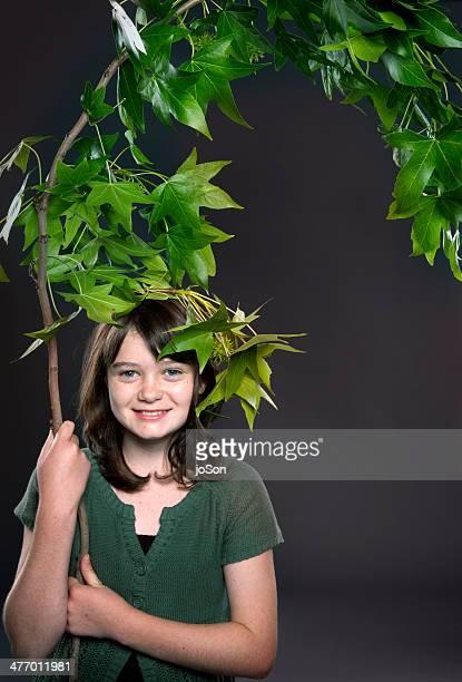 Teenager girl holding tree branche smile