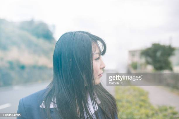 teenager girl looking at school ground after school - female high school student stock pictures, royalty-free photos & images