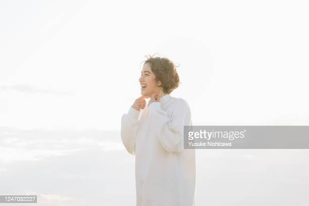 a teenager girl looking into the distance and laughing - yusuke nishizawa stock pictures, royalty-free photos & images