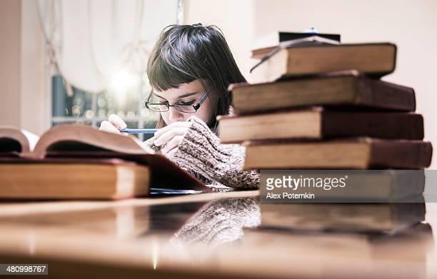 Teenager girl make a homework