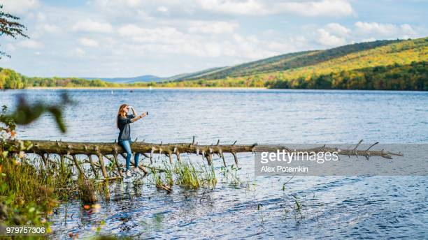 teenager girl make selfie at the mauch chunk lake in poconos, pennsylvania - jim thorpe pennsylvania stock photos and pictures