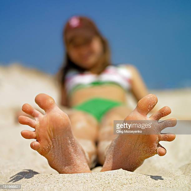 teenager girl on beach - little girl soles stock photos and pictures