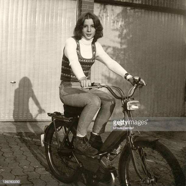 teenager girl on motorbike - 1970年 ストックフォトと画像