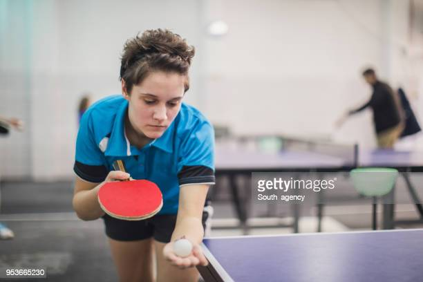 teenager girl playing ping pong - table tennis stock pictures, royalty-free photos & images