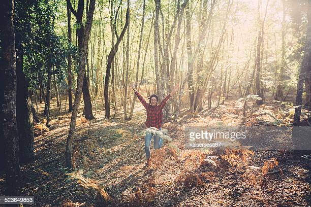 Teenager girl running in the forest