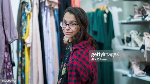 teenager girl shopping in the clothing store - alex potemkin or krakozawr stock pictures, royalty-free photos & images
