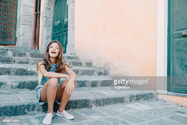 Teenager Girl Sitting on Stairs Outdoors