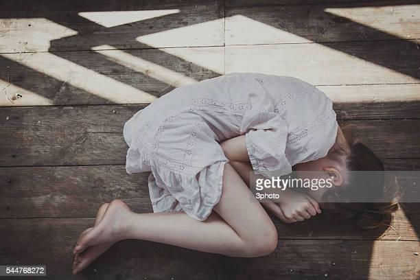 Teenager girl sleeping in a sunlit loft