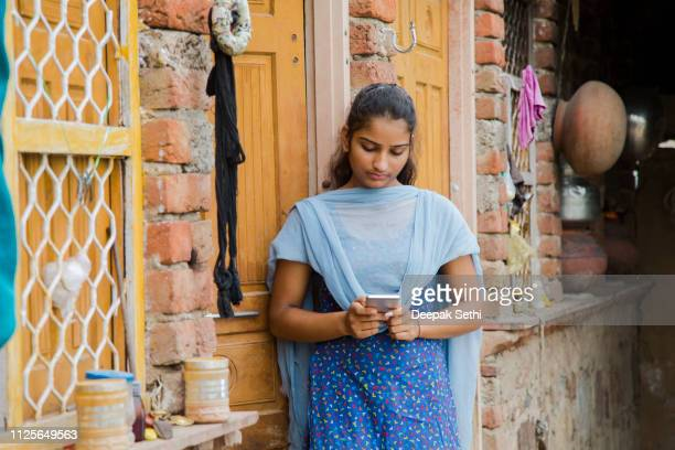 teenager girl - stock images - village stock pictures, royalty-free photos & images