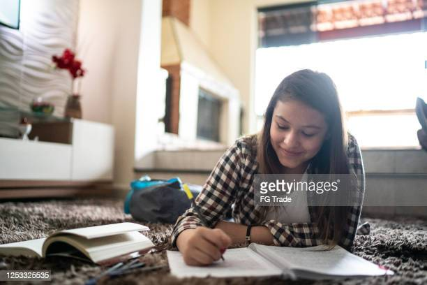 teenager girl studying at home - handwriting stock pictures, royalty-free photos & images