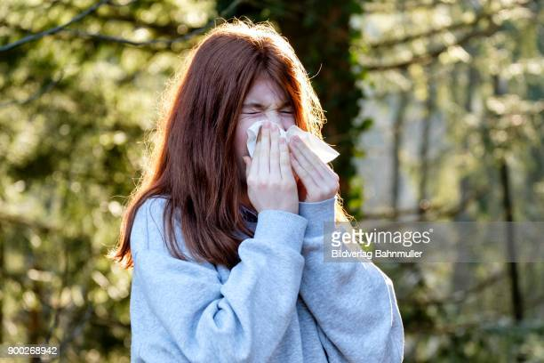 teenager, girl wiping her nose, runny nose, allergy, germany - sniffare droga foto e immagini stock