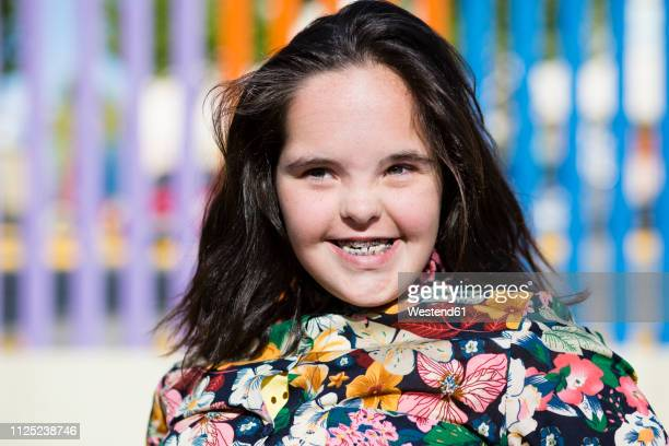 teenager girl with down syndrome smiling, braces - down blouse stock pictures, royalty-free photos & images