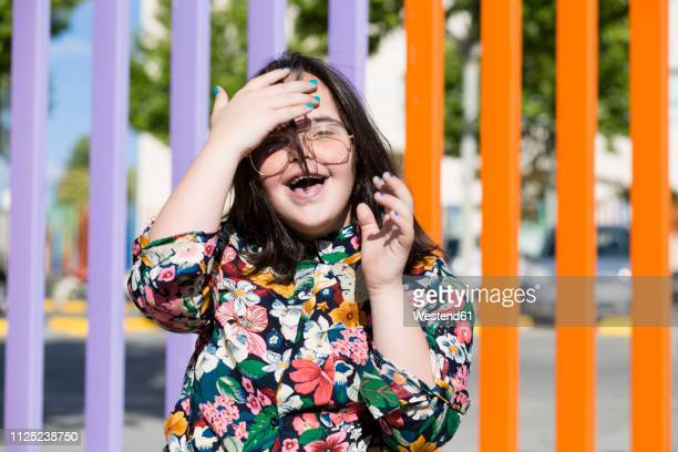 teenager girl with down syndrome wearing glasses and smiling - down blouse stockfoto's en -beelden