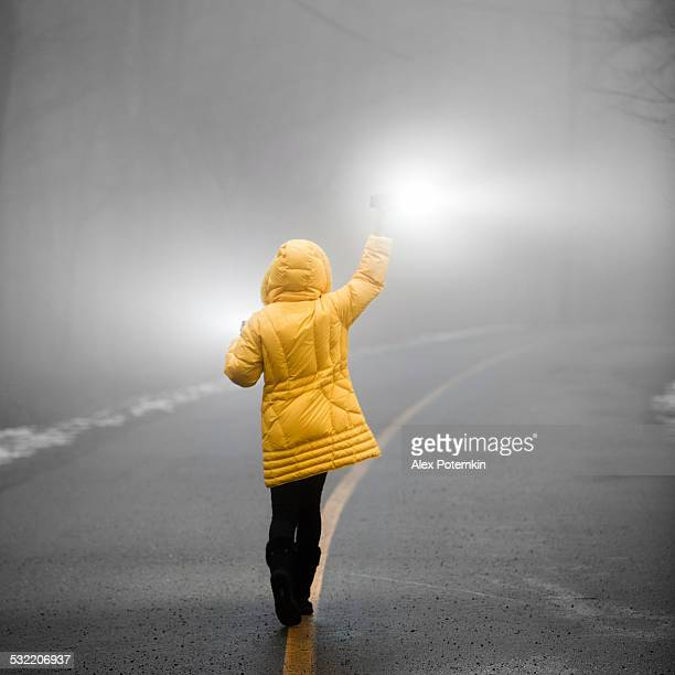 teenager girl with flashlights walking in the haze - alex potemkin or krakozawr stock pictures, royalty-free photos & images