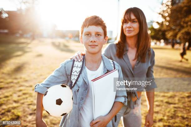 teenager go to school with mom