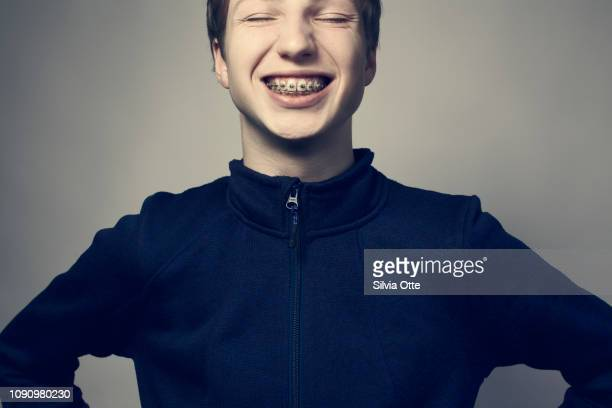 Teenager grinning exposing braces