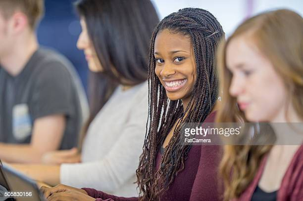 Teenager Happily Sitting in Class