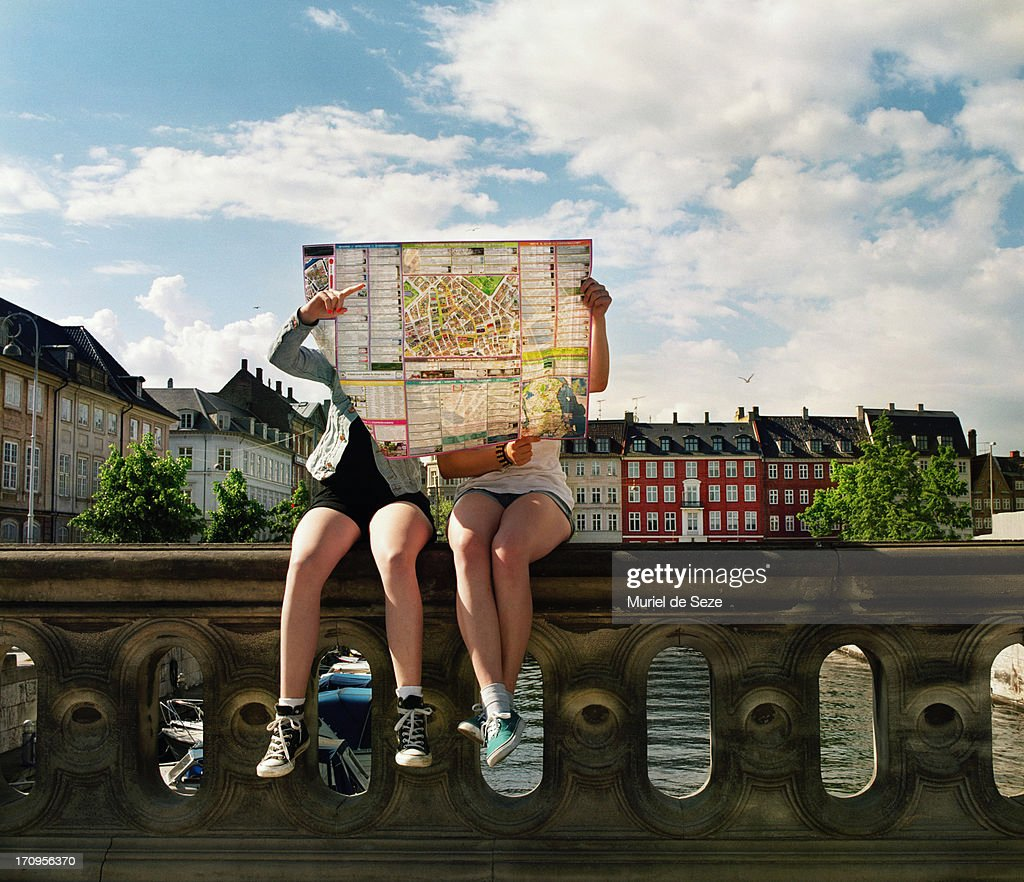 Teenager hidden by city map : Stock Photo