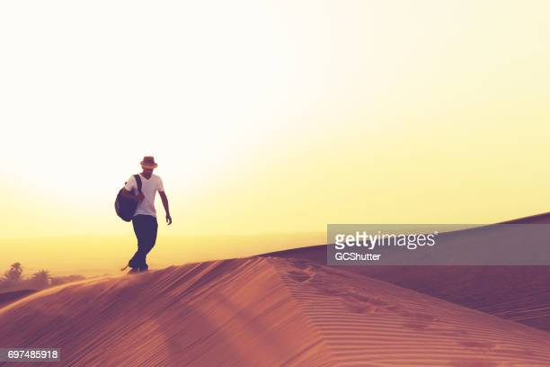 Teenager hiking Dunes of Arabia