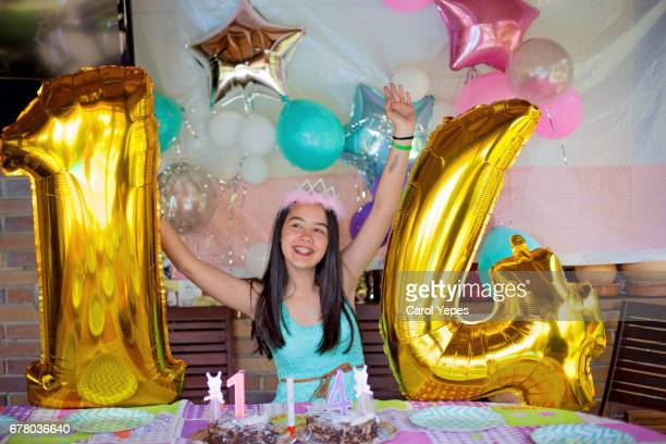 teenager holding 14 number balloons on her birthday - number 14 stock photos and pictures