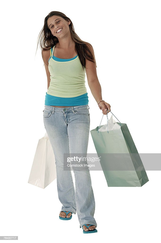 Teenager holding shopping bags : Stockfoto