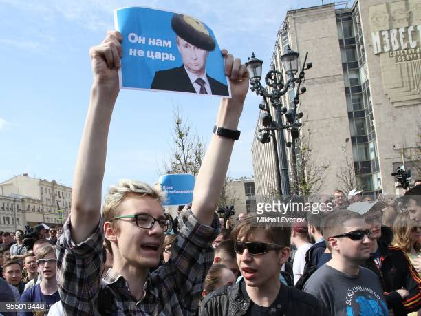 A teenager holds a poster shouting antiPutin slogans during the demonstration against President Vladimir Putin at Pushkin Square May 5 2018 in Moscow...