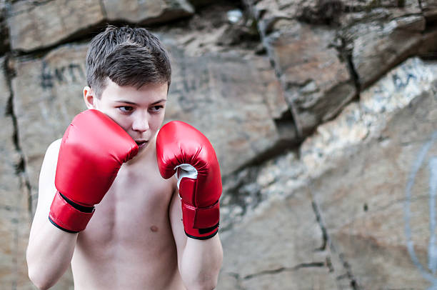 teen-guy-in-boxing-ring