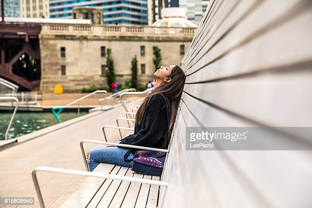 teenager in chicago downtown relaxing waiting for friends - good; times bad times stock pictures, royalty-free photos & images