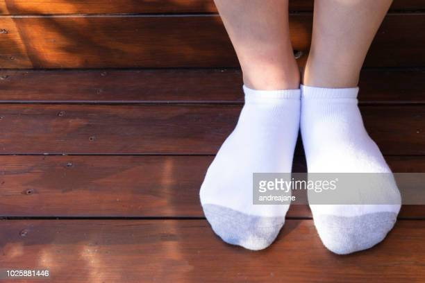teenager in socks - teenage girls feet stock pictures, royalty-free photos & images
