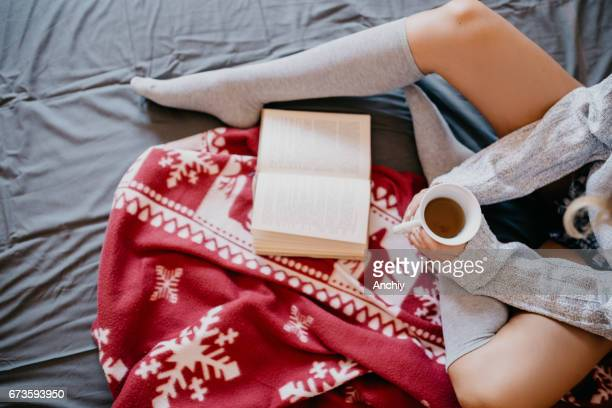 teenager is having a morning coffee in the bed - girls in socks stock photos and pictures
