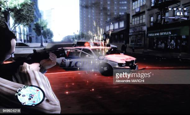A teenager is playing with the new popular video game Grand Theft Auto IV that has been on the market for one week The game has been forbidden to...